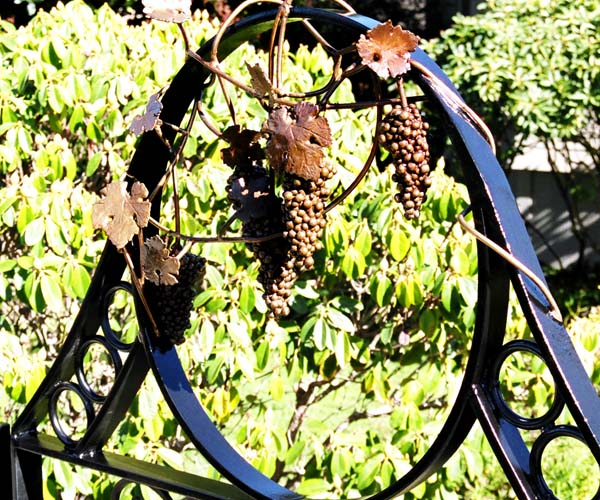 Steppin' Out Magazine Bronze Grape Cluster Gate Sculpture